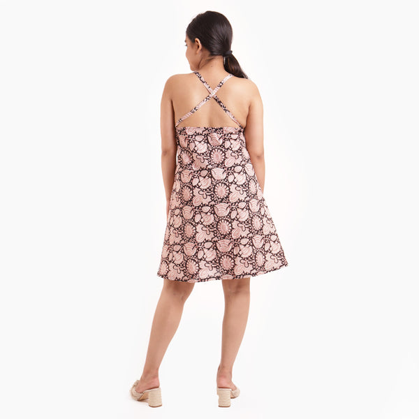 Back View of a Model wearing Floral Criss Cross Back Loose Fit Dress