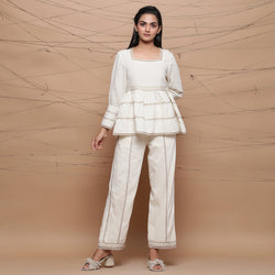 Front View of a Model wearing Chic Jute Laced Peplum Top and Pant Set