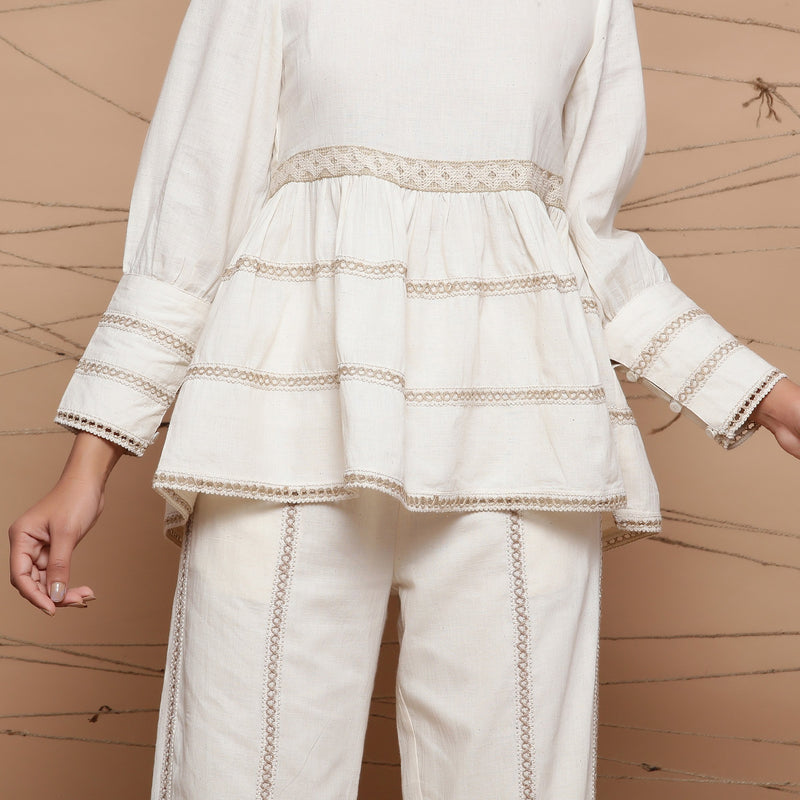 Front Detail of a Model wearing Chic Jute Laced Peplum Top and Pant Set