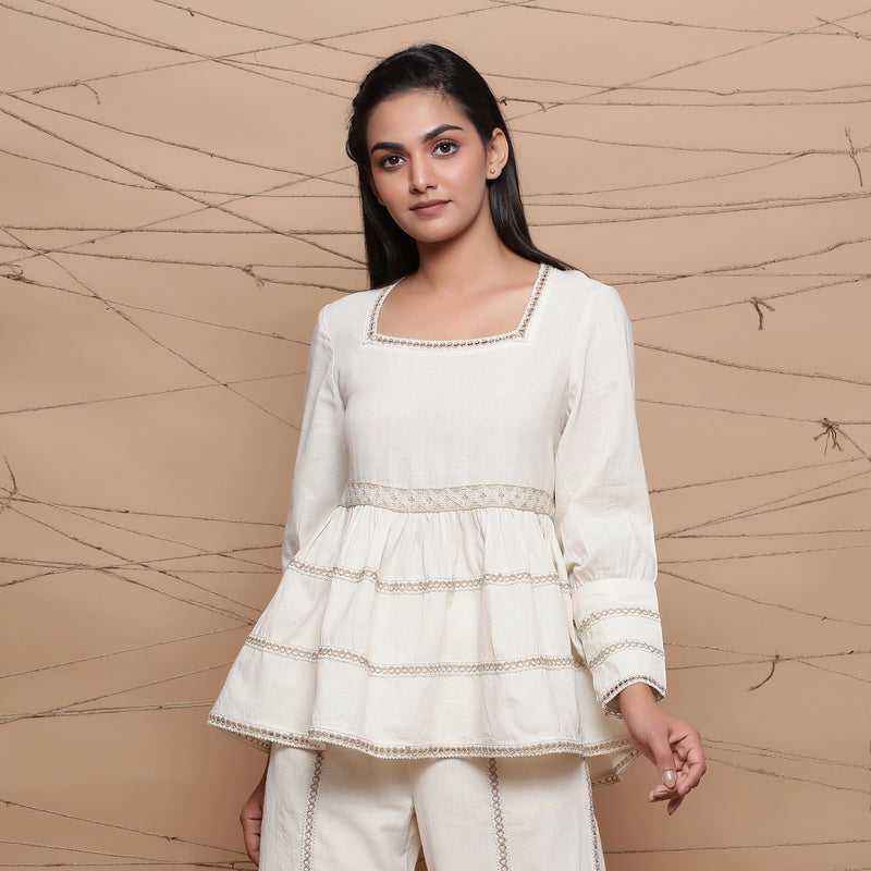 Front View of a Model Wearing Undyed Peplum Jute Lace Gathered Top