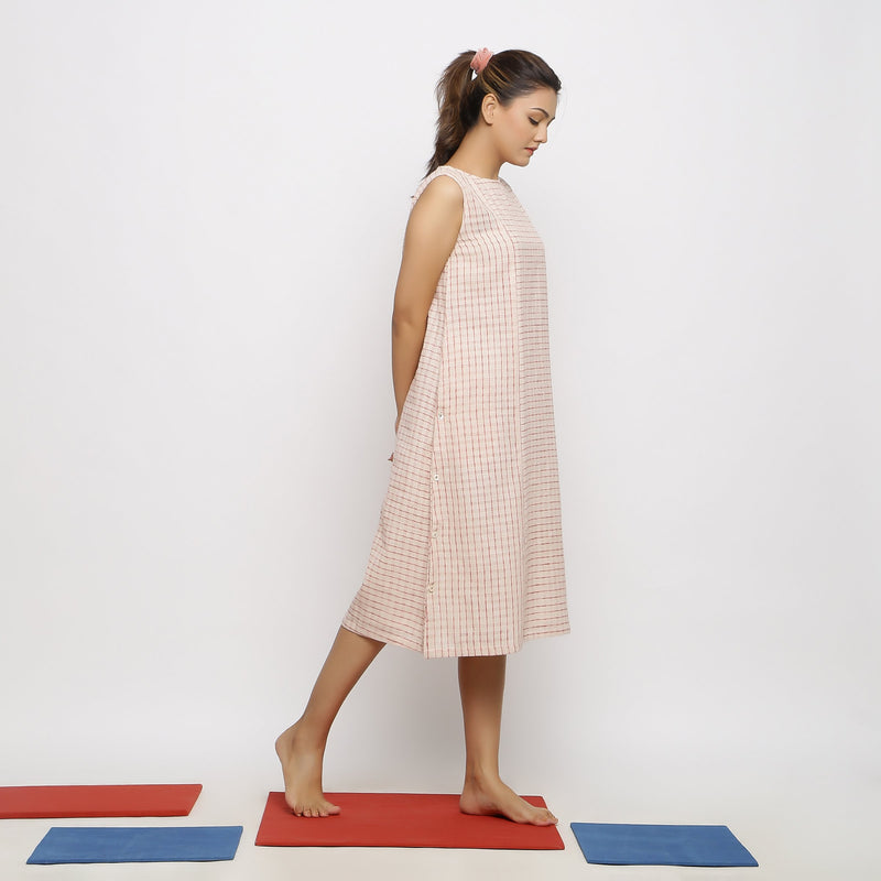 Right View of a Model wearing Flowy Pink Paneled Dress