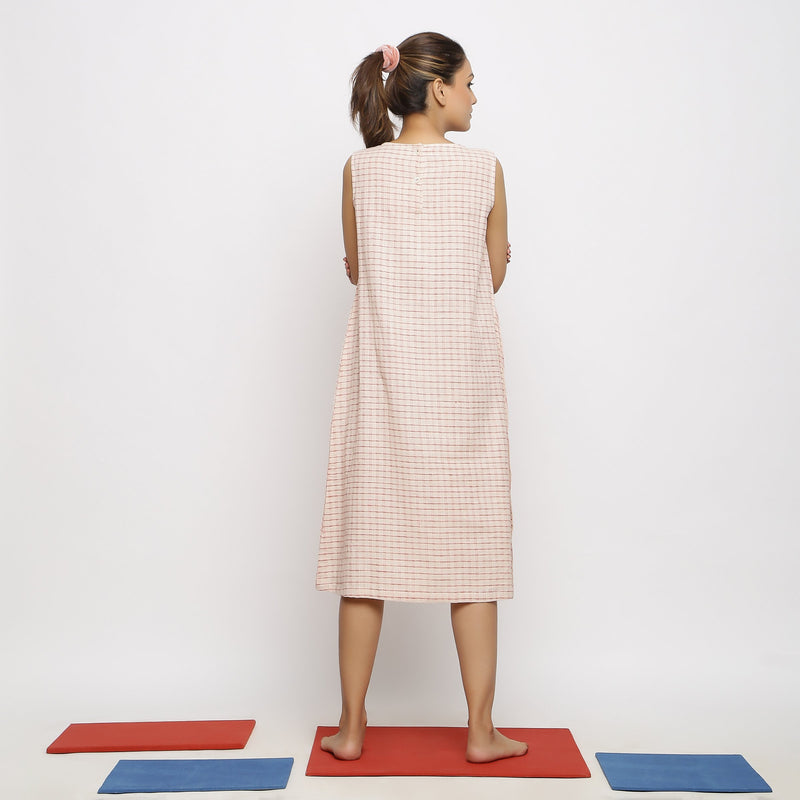 Back View of a Model wearing Flowy Pink Paneled Dress