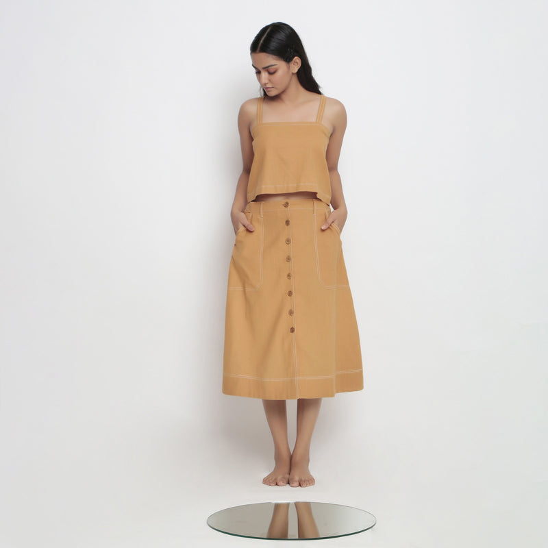 Front View of a Model Wearing Minimal Handspun Rust Top and Skirt Set