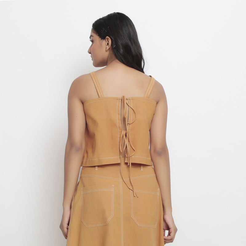 Back View of a Model Wearing Minimal Handspun Rust Top and Skirt Set