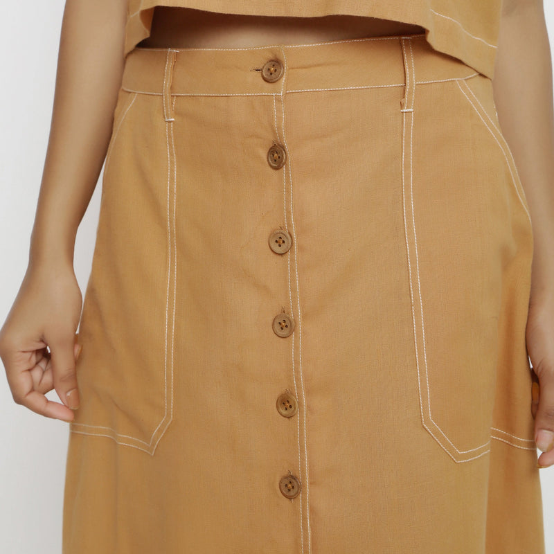 Front Detail of a Model Wearing Rustic Vegetable Dyed Button-Down Skirt