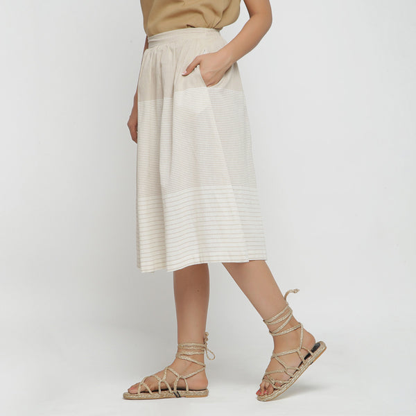Left View of a Model wearing Striped Pleated High Rise Paneled Skirt