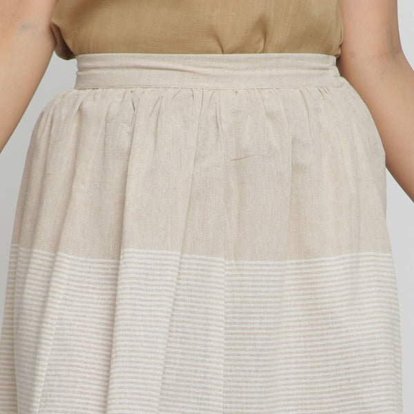 Front Detail of a Model wearing Flowy Striped Pleated Skirt