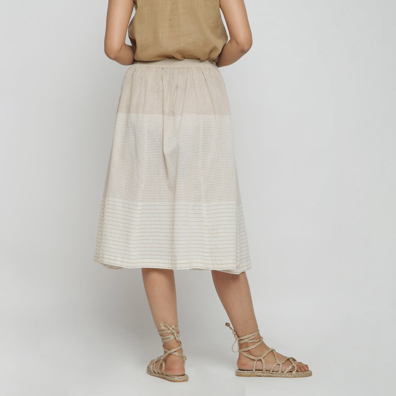 Back View of a Model wearing Flowy Striped Pleated Skirt