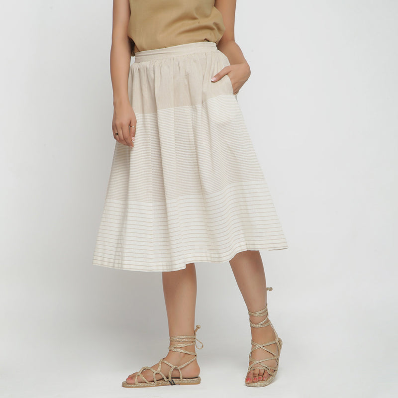 Left View of a Model wearing Flowy Striped Pleated Skirt
