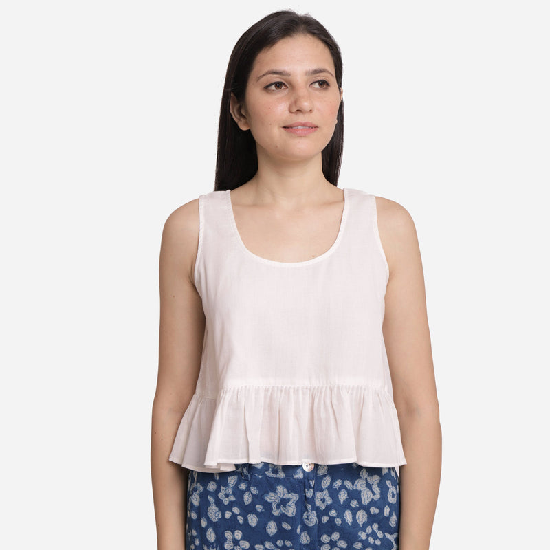 Front View of a Model wearing White Round Neck Cotton Peplum Top