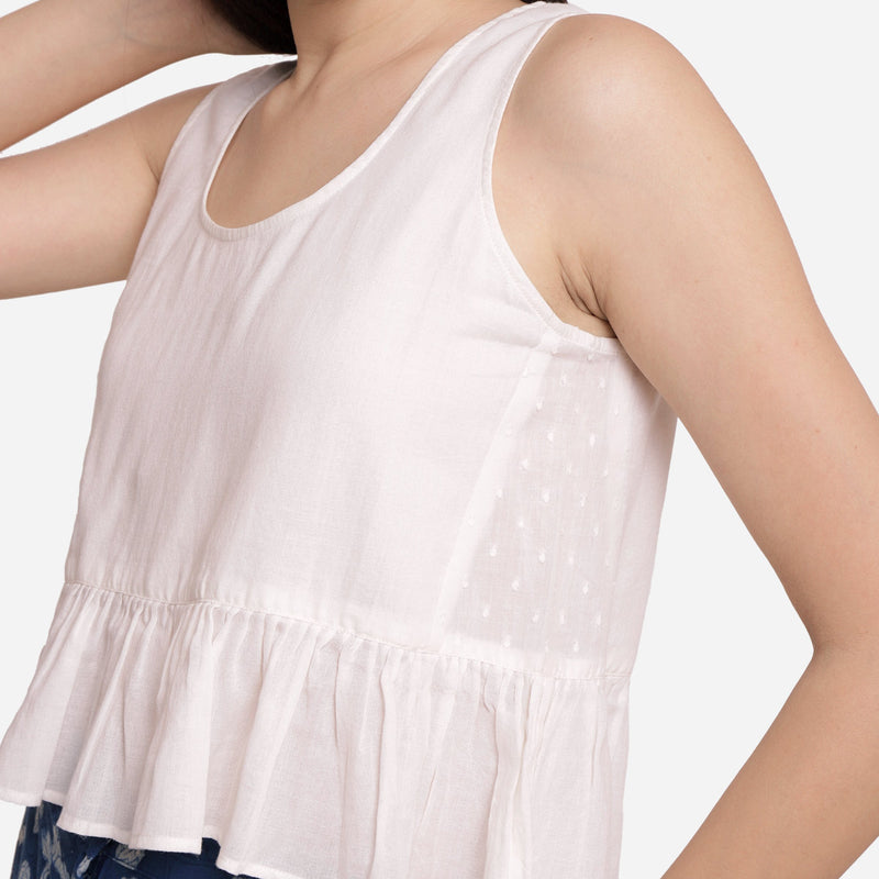 Left Detail of a Model wearing White Round Neck Cotton Peplum Top