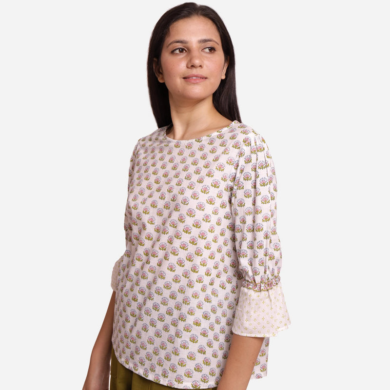 Left View of a Model wearing Block Printed Frilled Puff Sleeves Top