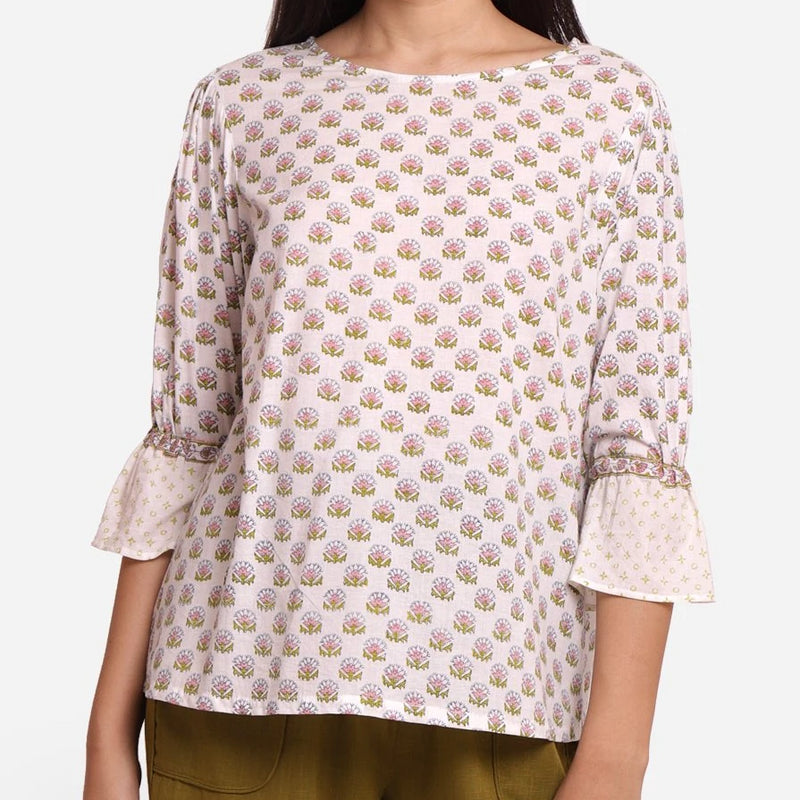 Front Detail of a Model wearing Block Printed Frilled Puff Sleeves Top