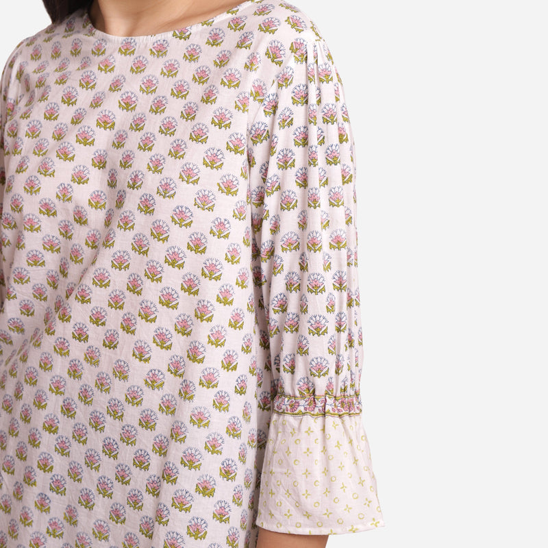 Left Detail of a Model wearing Block Printed Frilled Puff Sleeves Top