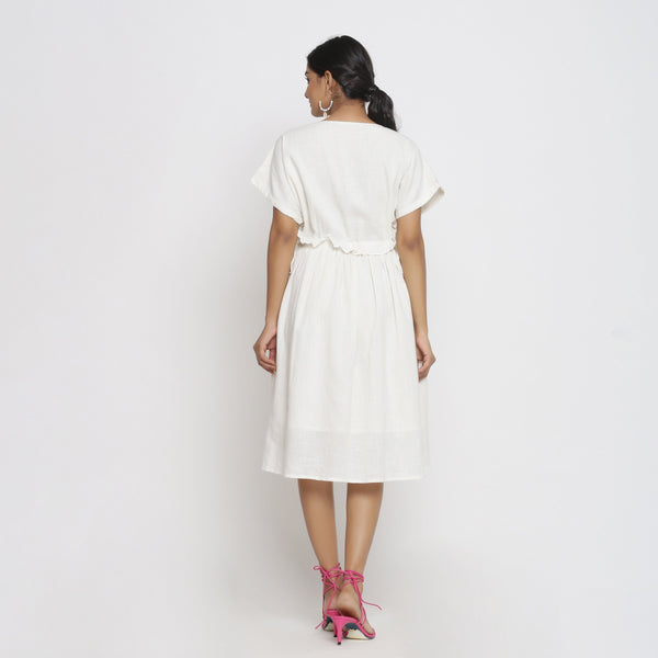 Back View of a Model wearing Frilled White Deep Neck Bohemian Dress