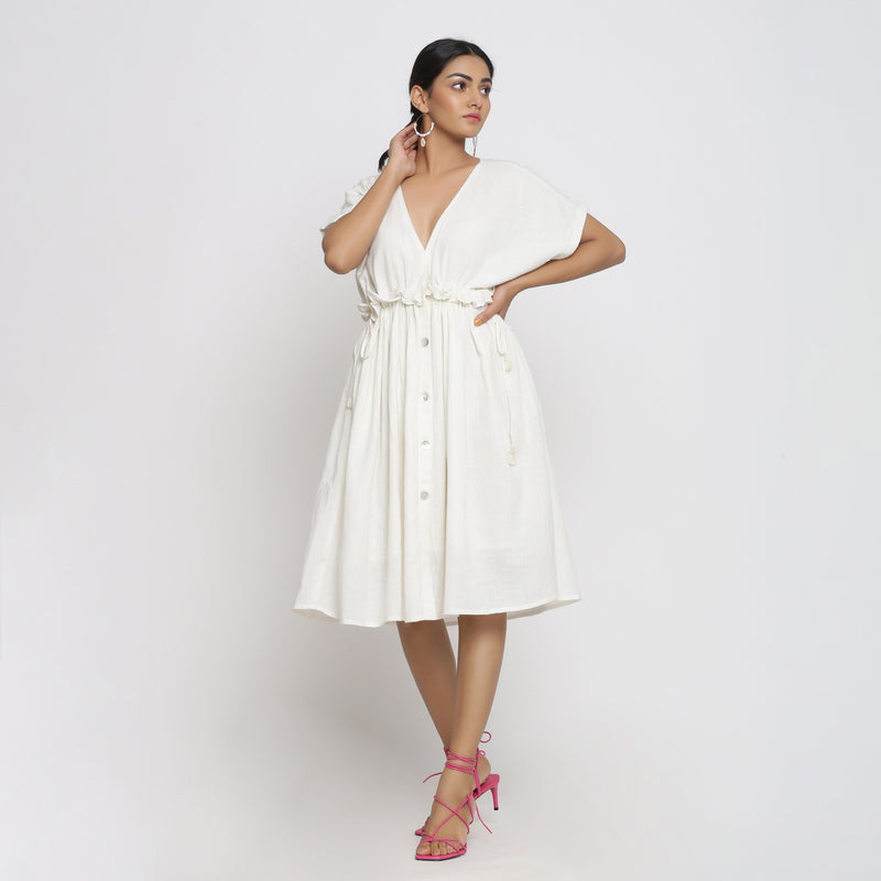 Front View of a Model wearing Frilled White Deep Neck Bohemian Dress