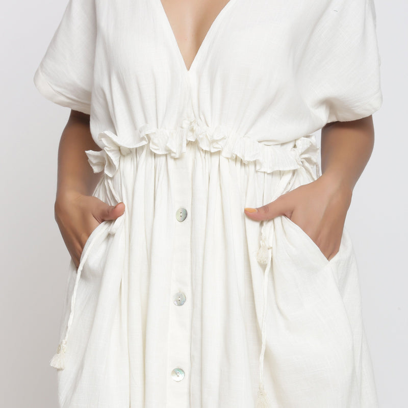 Front Detail of a Model wearing Frilled White Deep Neck Bohemian Dress