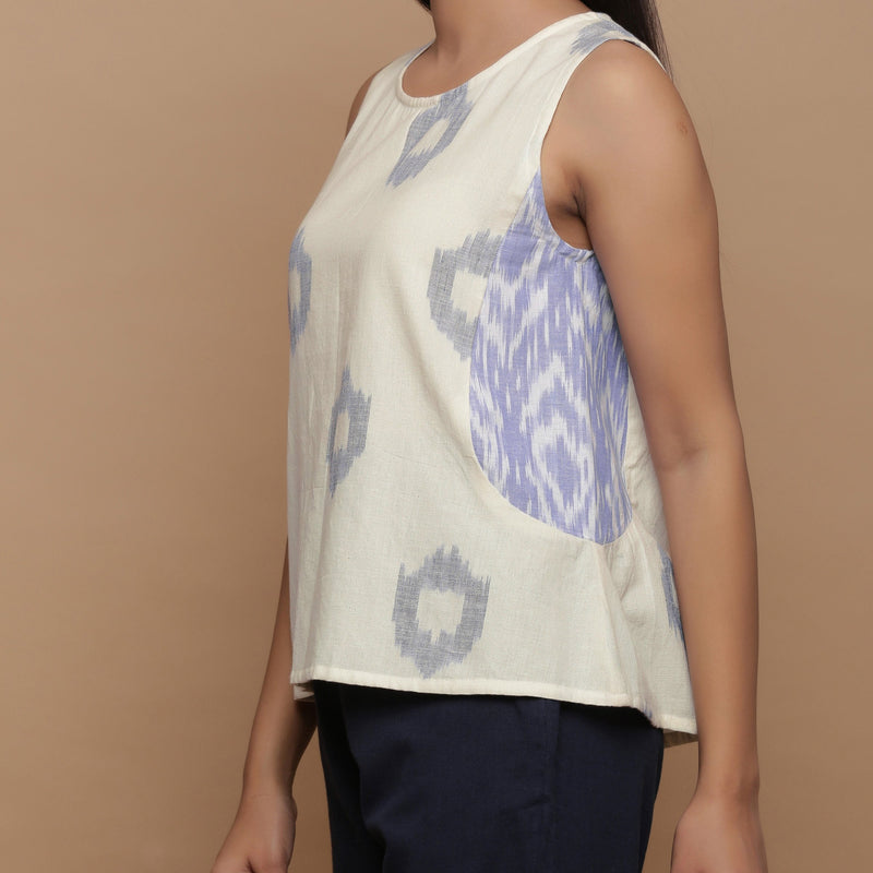 Left View of a Model wearing Geometric Off-White Cotton Paneled Top