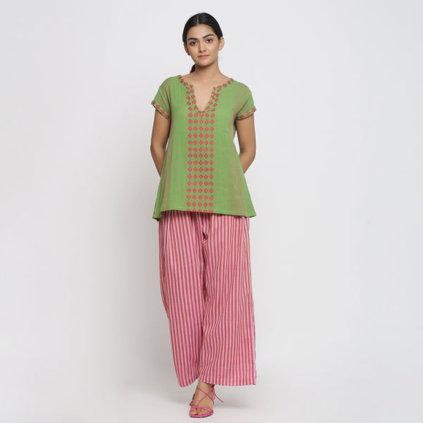 Front View of a Model wearing Green And Red Yarn Dyed A-Line Top