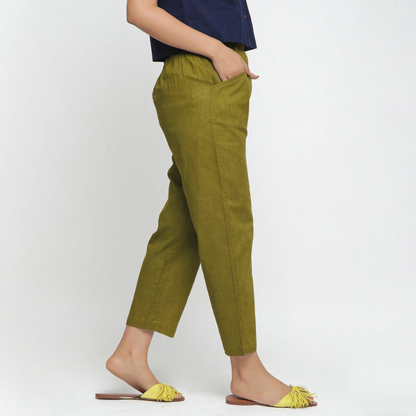 Right View of a Model wearing Green Ankle Length Mid-Rise Chinos