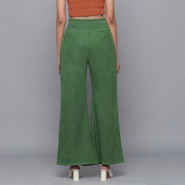 Back View of a Model wearing Green Corduroy Striped Bootcut Pant