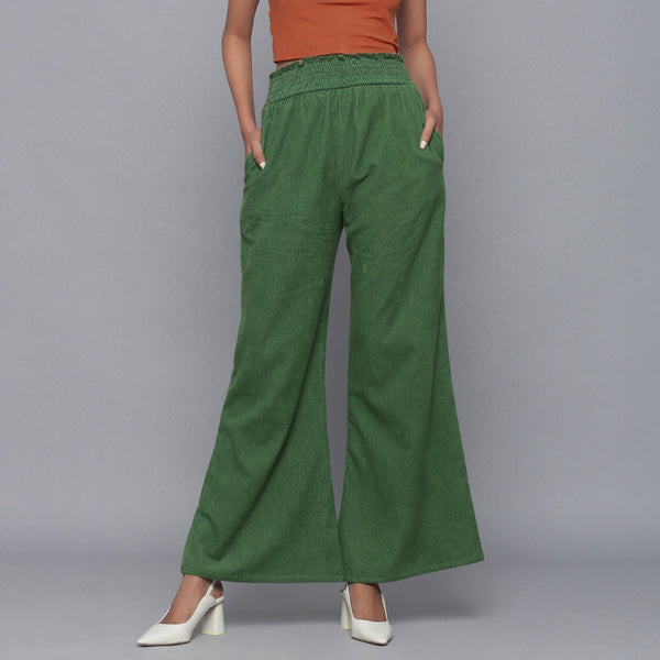 Front View of a Model wearing Green Corduroy Striped Bootcut Pant