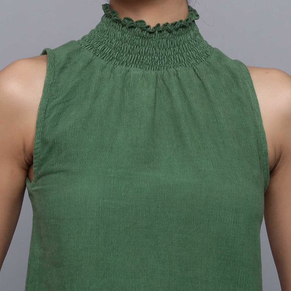 Front Detail of a Model wearing Green Cotton Corduroy High Neck Top
