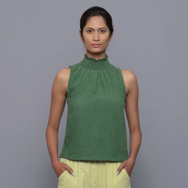 Front View of a Model wearing Green Corduroy High Neck Top