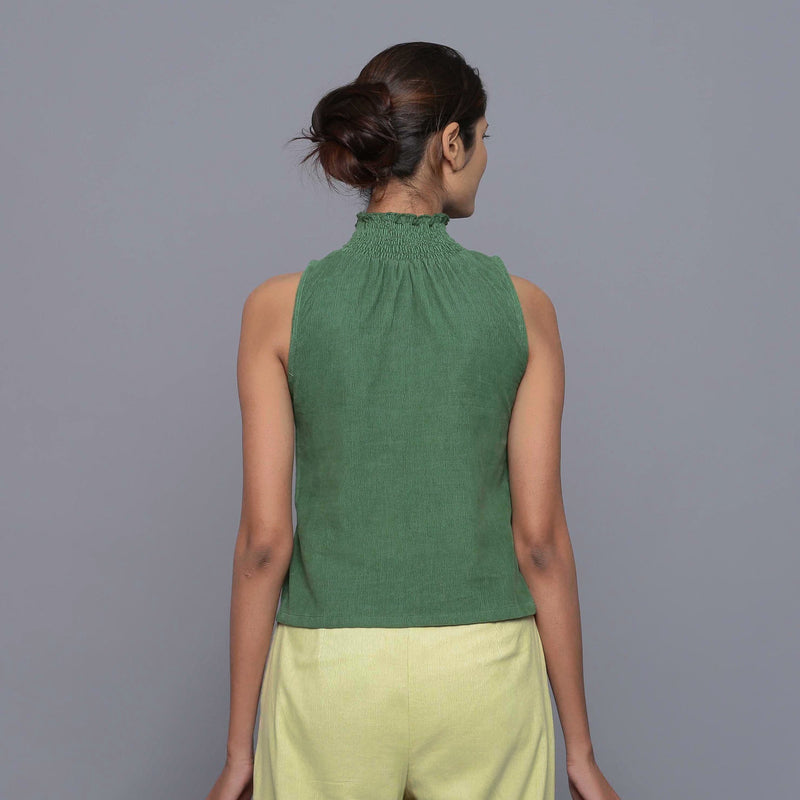 Back View of a Model wearing Green Cotton Corduroy High Neck Top