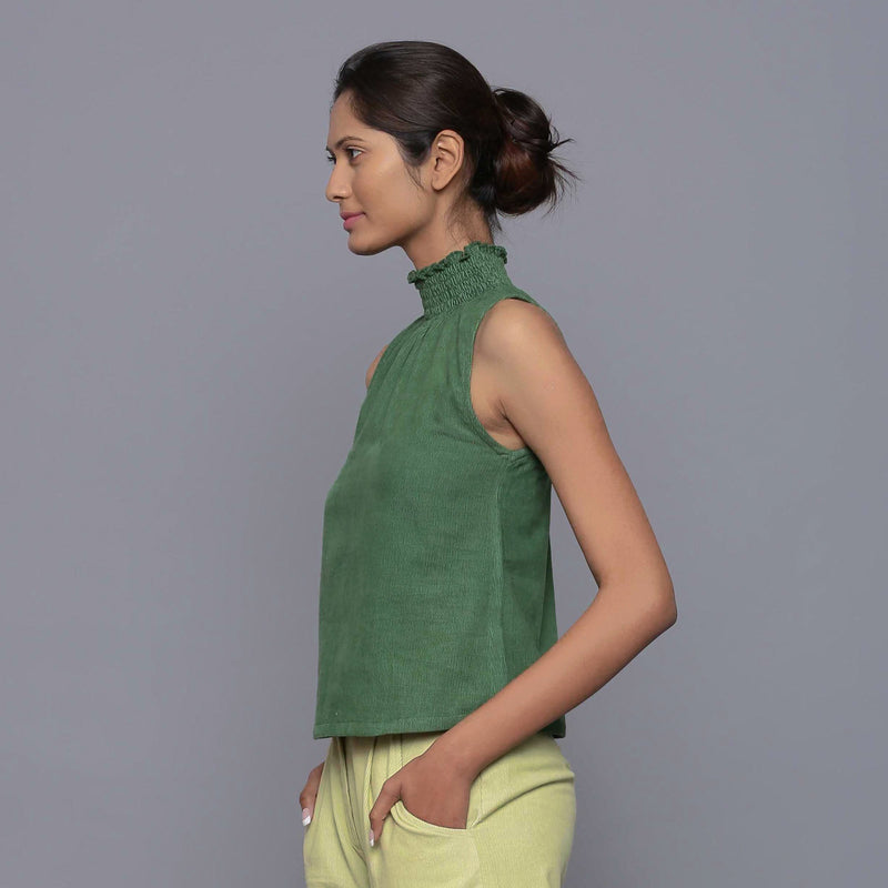 Left View of a Model wearing Green Cotton Corduroy High Neck Top
