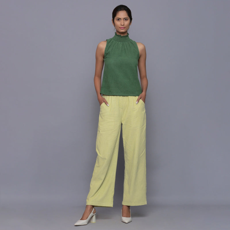 Front View of a Model wearing Green Cotton Corduroy High Neck Top