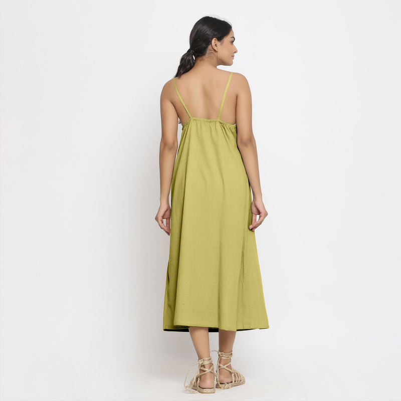 Back View of a Model wearing Green Cotton Flax Strap Sleeve A-Line Dres