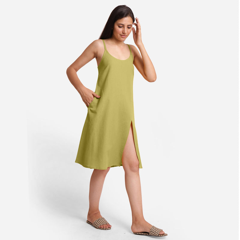 Right View of a Model wearing Green Cotton Flax Strappy Slit Dress