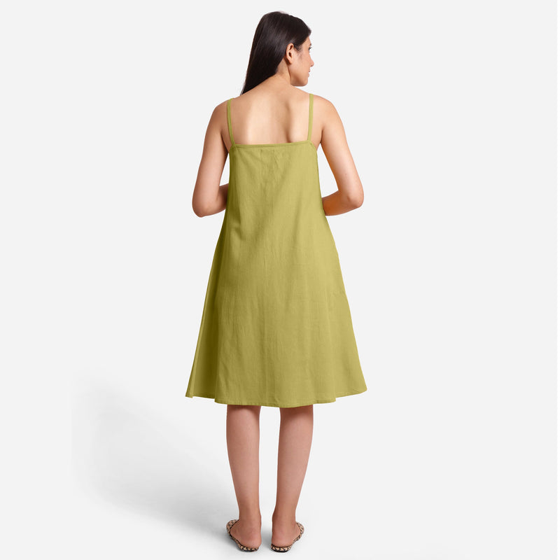 Back View of a Model wearing Green Cotton Flax Strappy Slit Dress