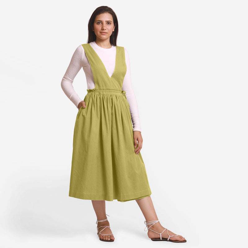 Front View of a Model wearing Green Deep Neck Pinafore Midi Wrap Dress