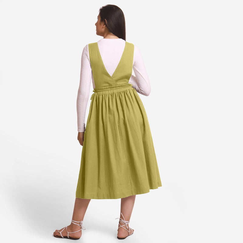 Back View of a Model wearing Green Deep Neck Pinafore Midi Wrap Dress