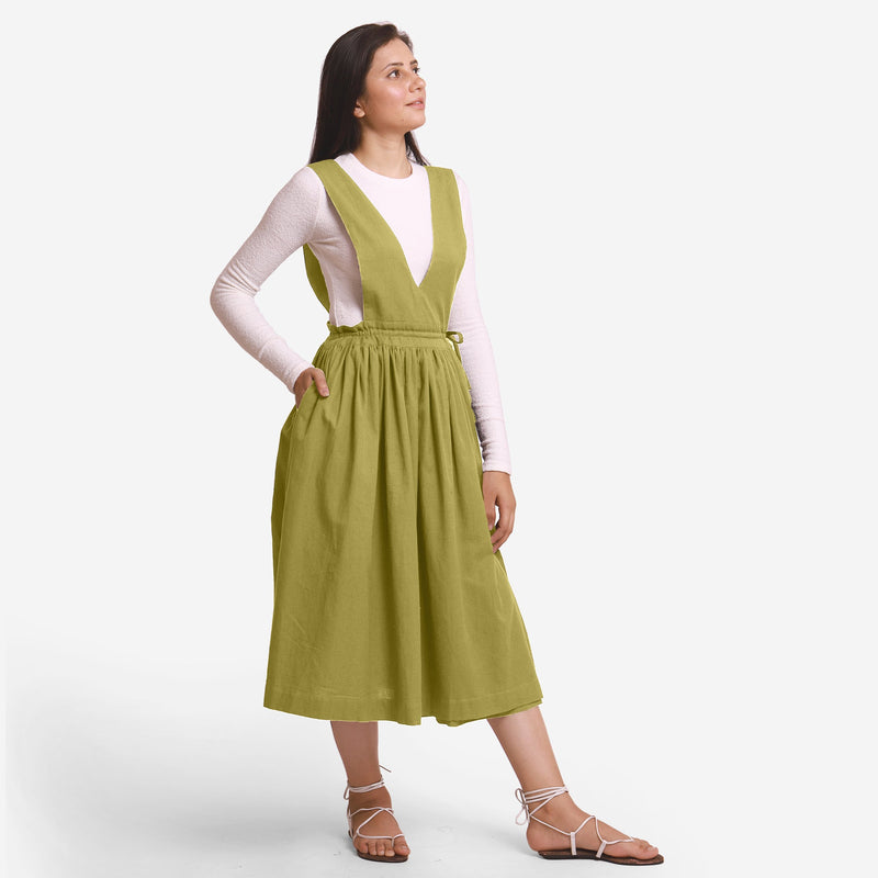 Right View of a Model wearing Green Deep Neck Pinafore Midi Wrap Dress