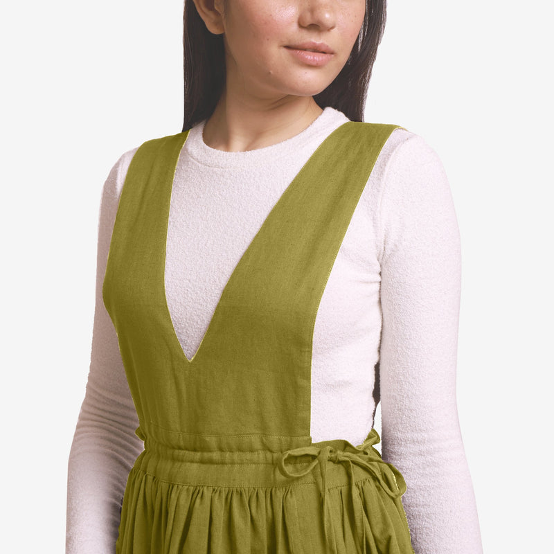 Front Detail of a Model wearing Green Deep Neck Pinafore Midi Wrap Dress