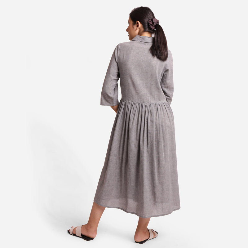 Back View of a Model wearing Grey Yarn Dyed Cotton Button-Down Dress
