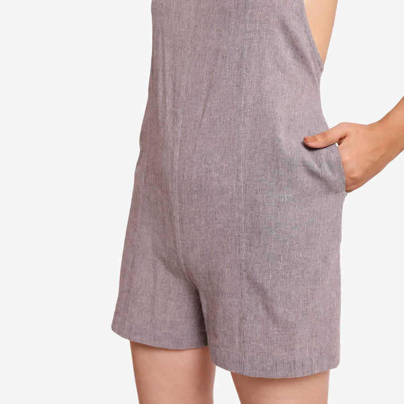 Left Detail of a Model wearing Grey Criss-Cross Back Paneled Romper