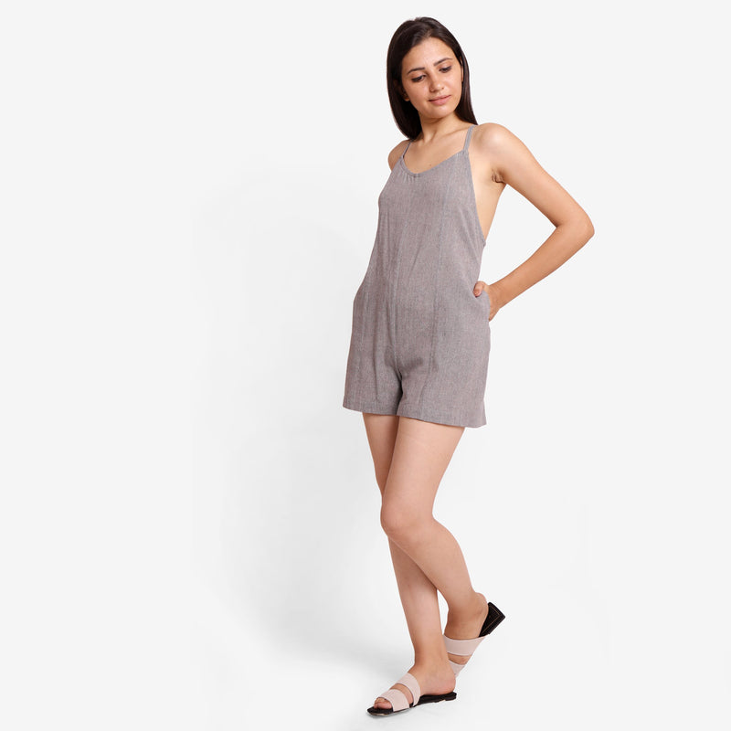 Left View of a Model wearing Grey Criss-Cross Back Paneled Romper