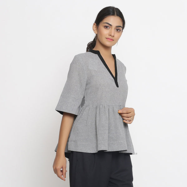 Right View of a Model wearing Solid Grey Yarn Dyed Cotton Peplum Top