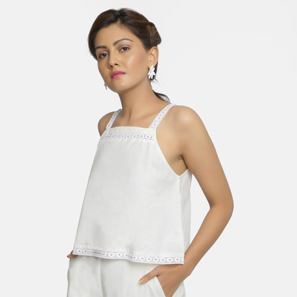 Left View of a Model wearing Hand-Beaded Organic Cotton Camisole Top