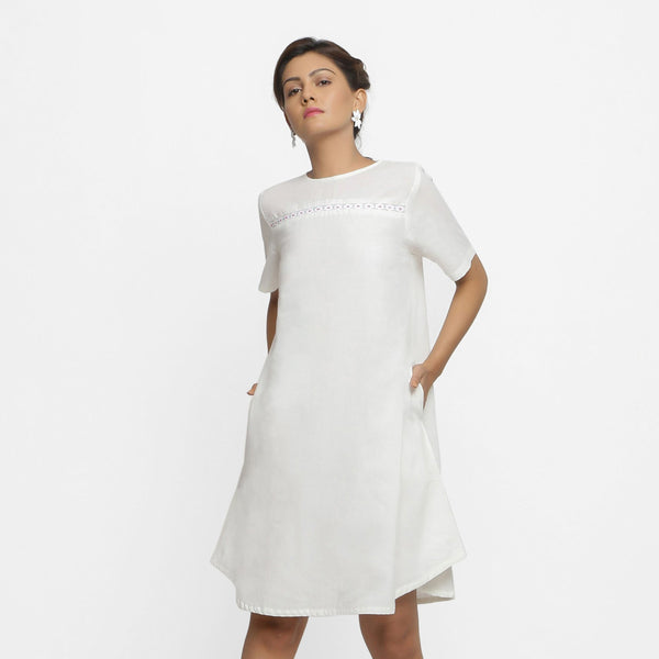 Front View of a Model wearing White Hand Beaded Cotton A-Line Dress