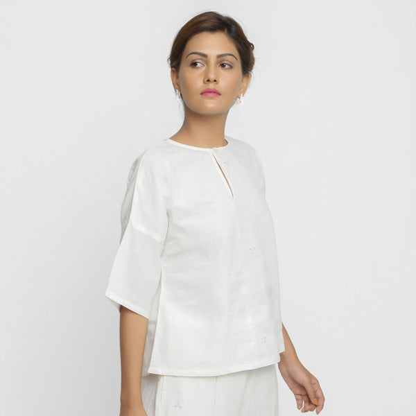 Right View of a Model wearing Hand Embroidered Organic Cotton Top