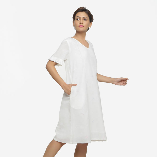 Right View of a Model wearing Hand-Embroidered Shift V-Neck Dress