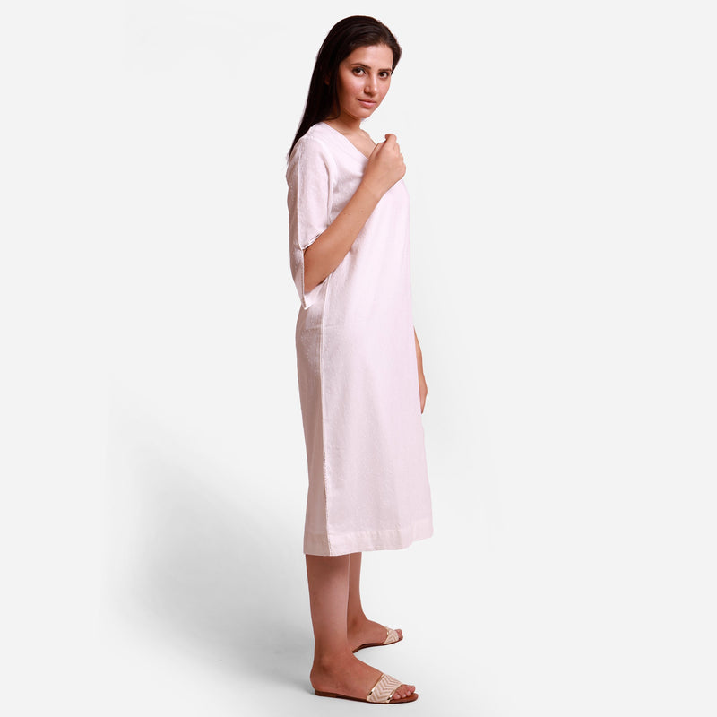 Right View of a Model wearing Hand Embroidered Cotton White Slit Dress