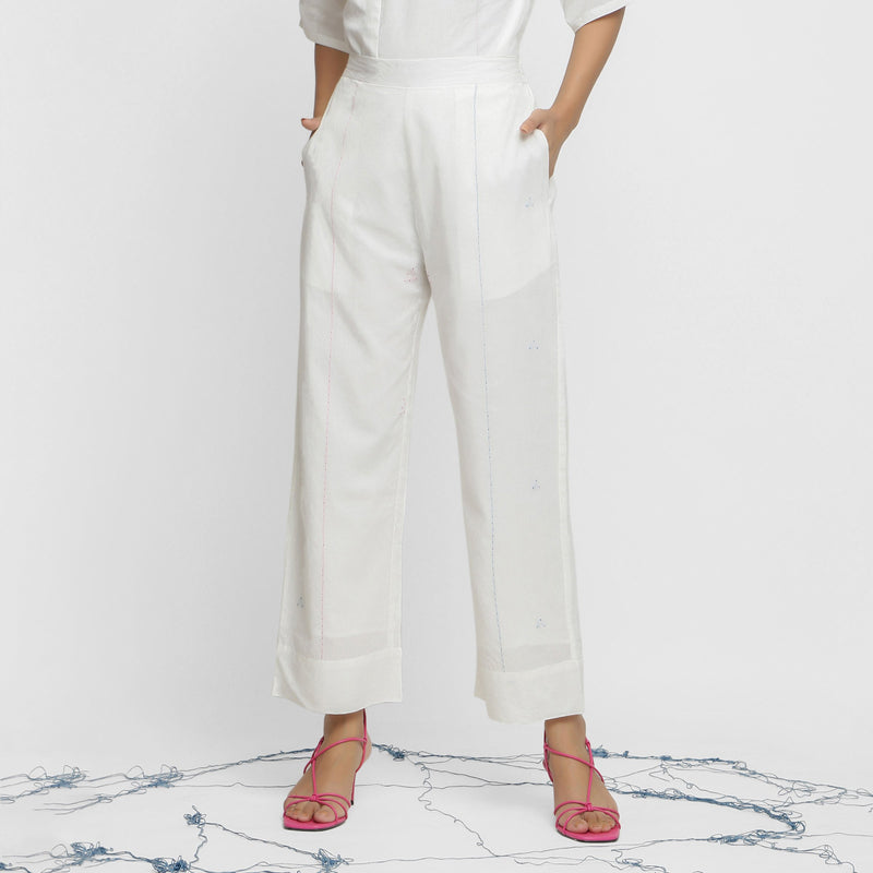 Front View of a Model wearing Hand-Embroidered White Straight Pant