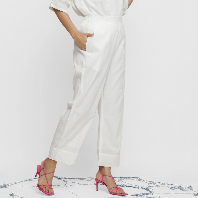 Right View of a Model wearing Hand-Embroidered White Straight Pant