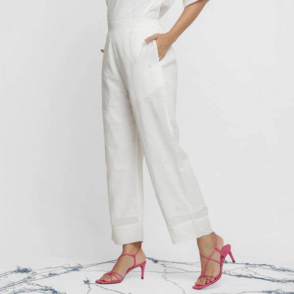 Left View of a Model wearing Hand-Embroidered White Straight Pant